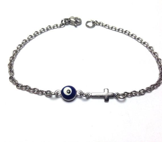 evil eye dark blue cross bracelet in stainless steel