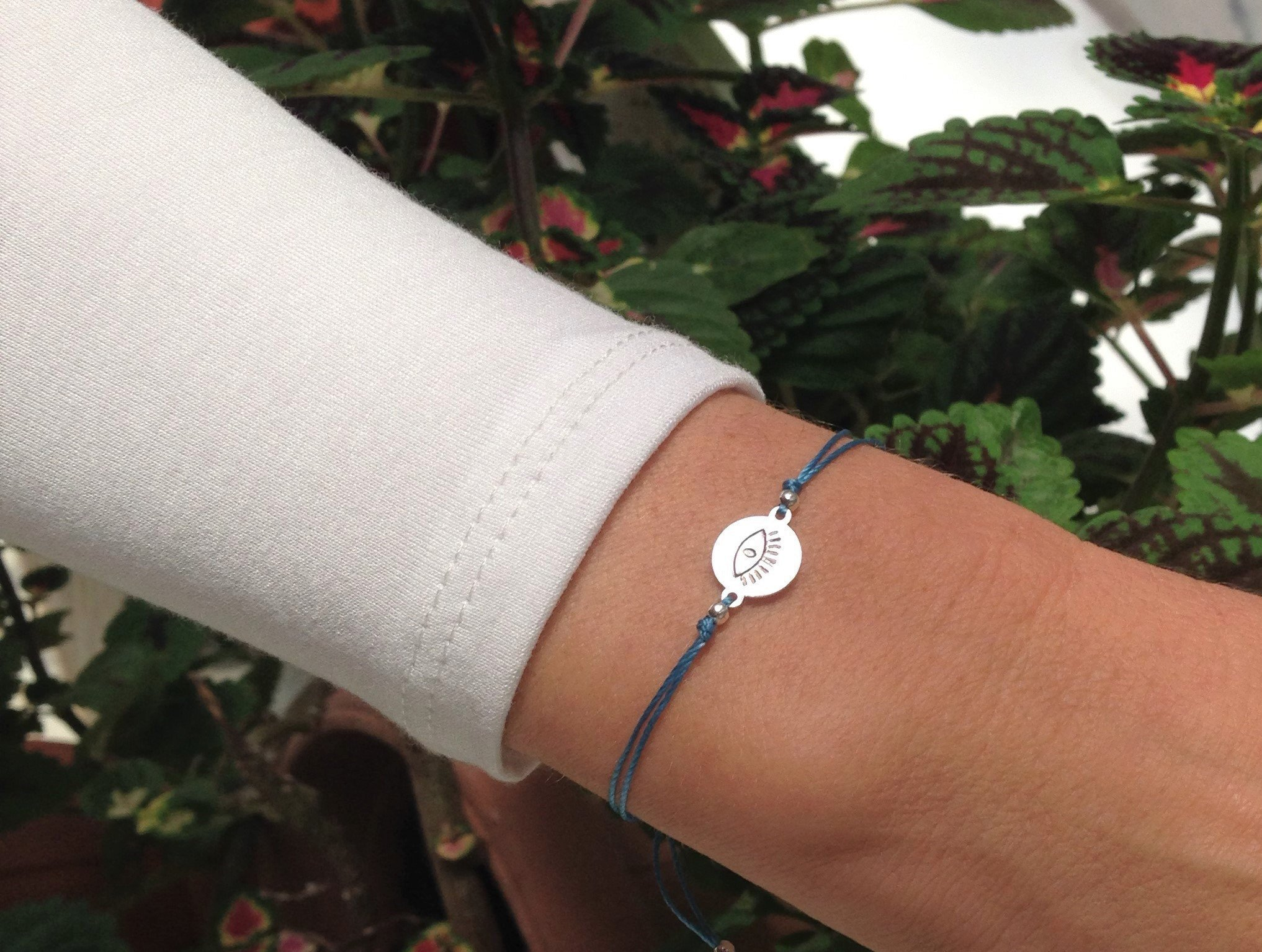 silver evil eye disc bracelet