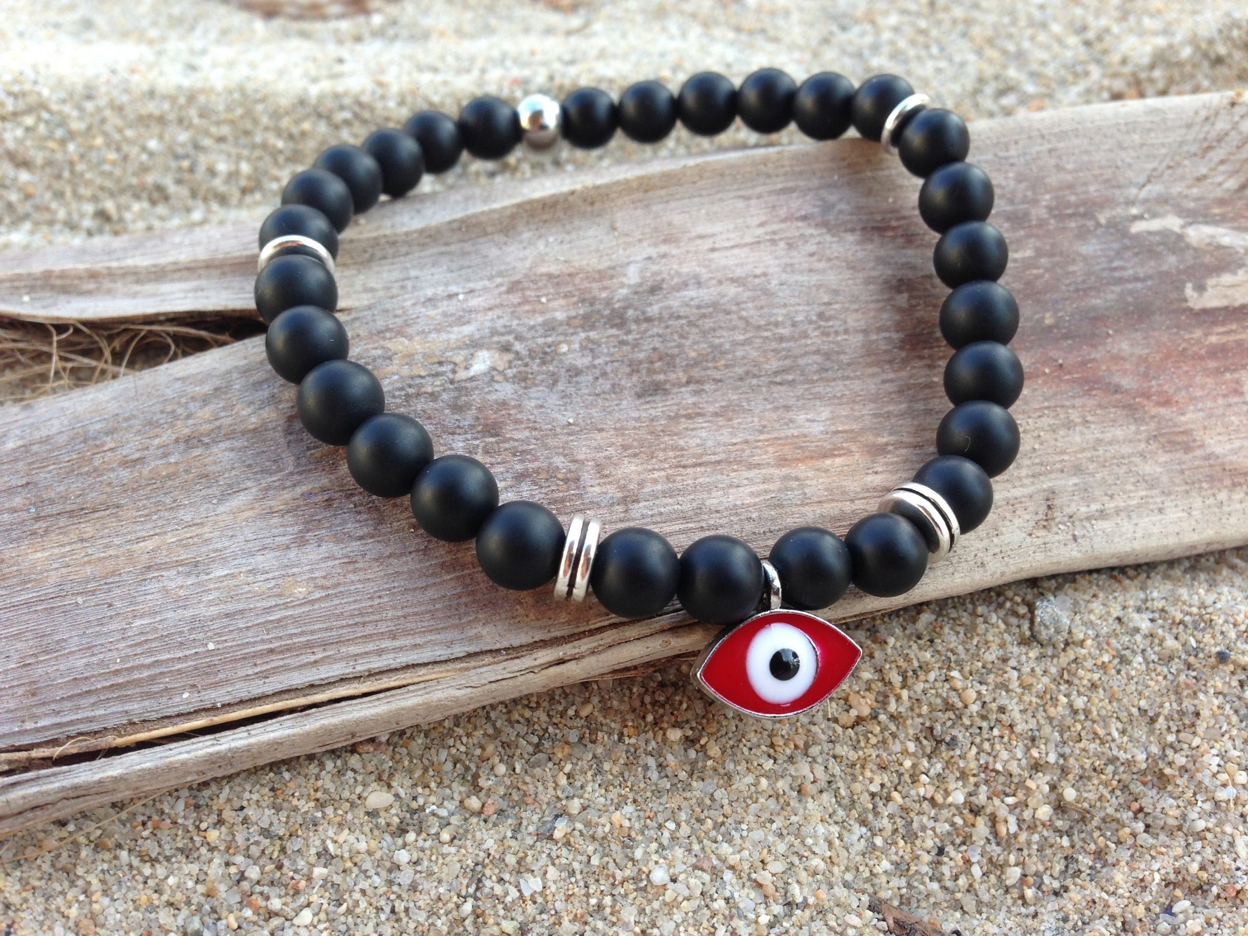 red evil eye bracelet with onyx beads