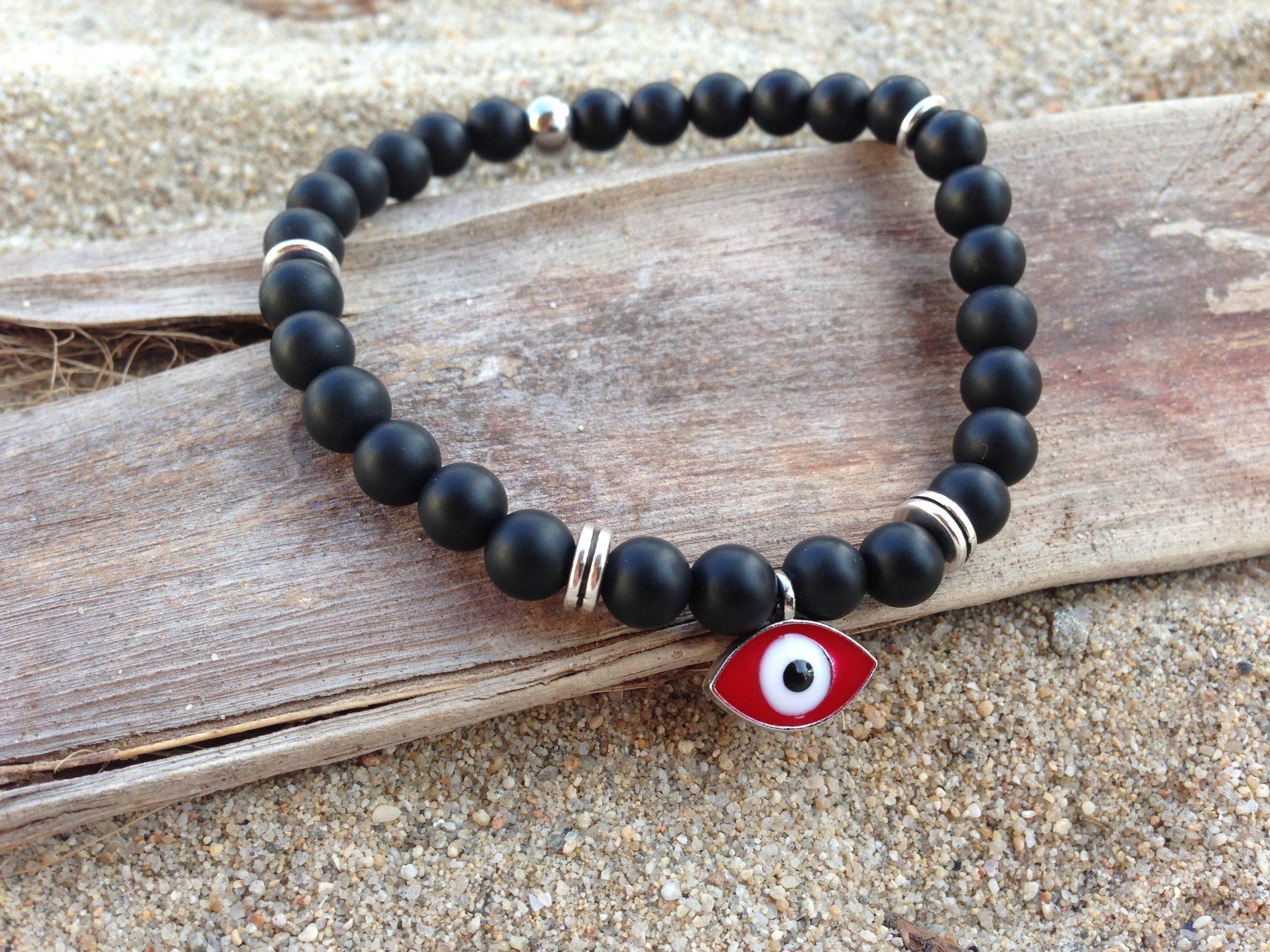 red evil eye bracelet with onyx beads